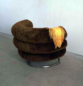 Liz Magor, Banff Chair, 1991, Steel base, soft polyurethane foam, synthetic fur, deerskin gloves, Purchased with the assistance of the Walter and Duncan Gordon Foundation Challenge Grant. Collection of McMaster Museum of Art, McMaster University.
